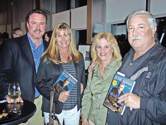 Left to right, Greg and Chell Amsler, Mitzi Like and Randy Moberg attended the Bourdain book signing to benefit the COC Culinary Arts Program.
