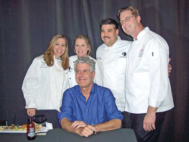 Celebrity chef Anthony Bourdain, seated, and the staff of the College of the Canyons Culinary Arts Program.