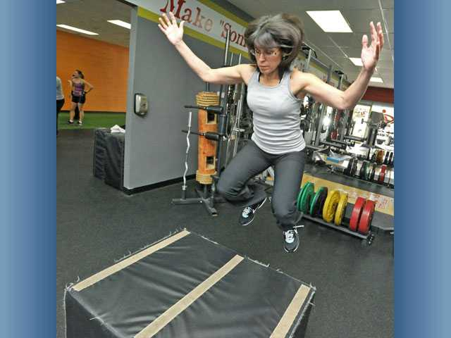 Amy Nolund practices box jumps.