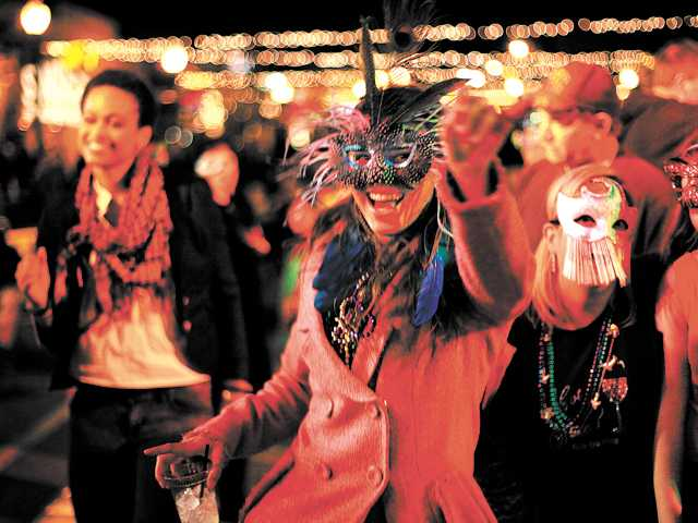 Liz Blake, 24, of Canyon Country, moves her feet to the music of Vaud and the Villains at the Senses Mardi Gras celebration in Newhall on Thursday.