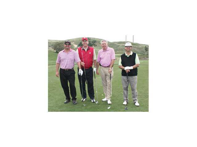 From left, Damian Jones, Jim Backer, Bob Hauter and a friend played in the 2011 Santa Clarita Valley Chamber of Commerce golf tournament raising money to support the chamber's activities.