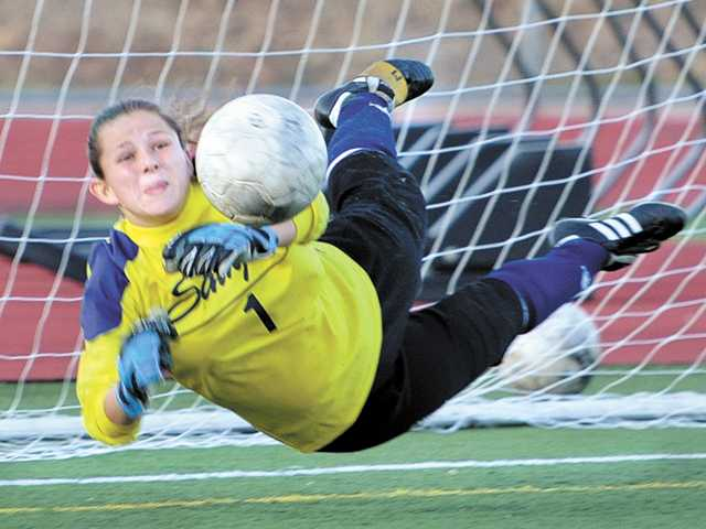 Saugus goalkeeper Maddie Hebert stops a penalty kick against Tesoro on Friday at Saugus High School.