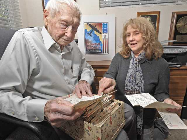 "Marilyn Hackett, right, and her father, Tom Johnson, 93, read some of the wartime love letters he wrote with Margaret Wolff, who became his wife in 1945. The letters are the heart of the stage show ""Wartime Romance,"" written by Hackett around the WWII love letters of her parents."