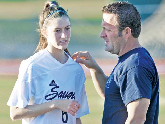Saugus senior striker Stacey Atwater (pictured, with assistant coach and Emergency Medical Technician Gary Helgeson) returned to the Centurions this past Friday after missing six games with a broken collarbone. Atwater has decided to try to continue her soccer career at College of the Canyons, a decision she made after missing time due to her injury.