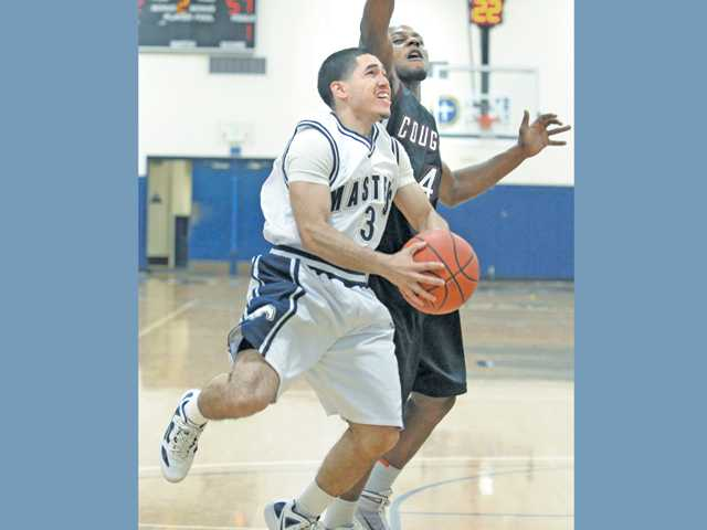 The Master's College guard Casey Trujeque (3) looks for a shot against Azusa Pacific on Tuesday at TMC.