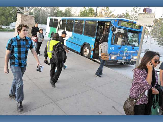 Passengers exit a city of Santa Clarita Transit bus at the McBean Transfer Station in Valencia on Wednesday. The city is currently working on a plan for the future of its public transportation system.