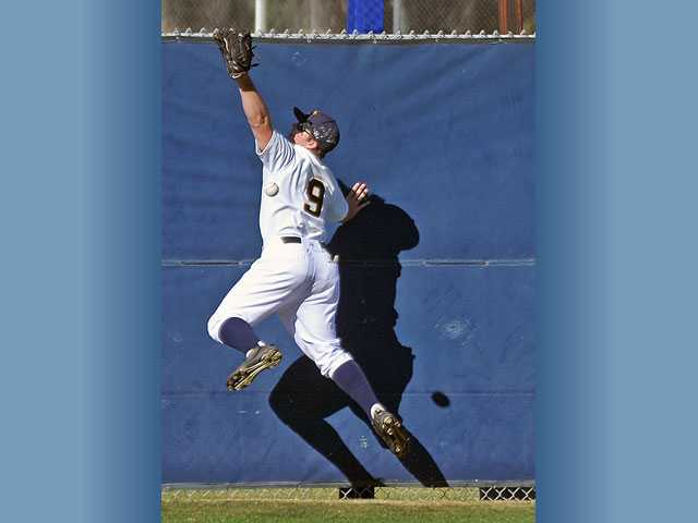 College of the Canyons outfielder Connor Garelick can't make the catch against Orange Coast on Thursday at COC. Orange Coast won 9-1.