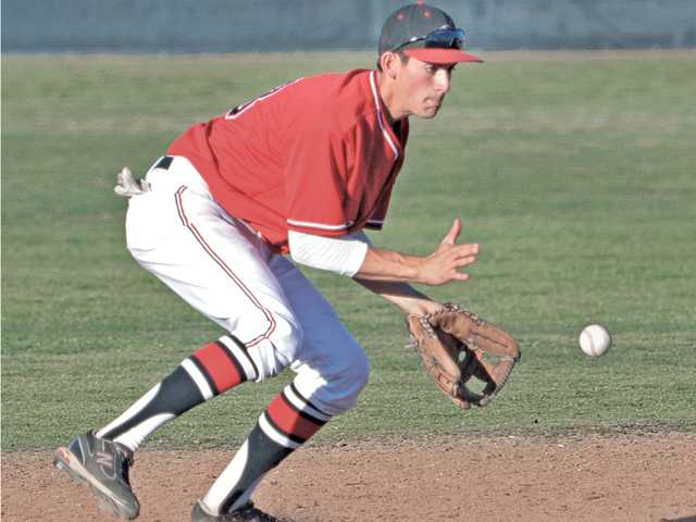 Hart shortstop Luke Persico fields a ground ball in the sixth inning on Friday at Hart High School.