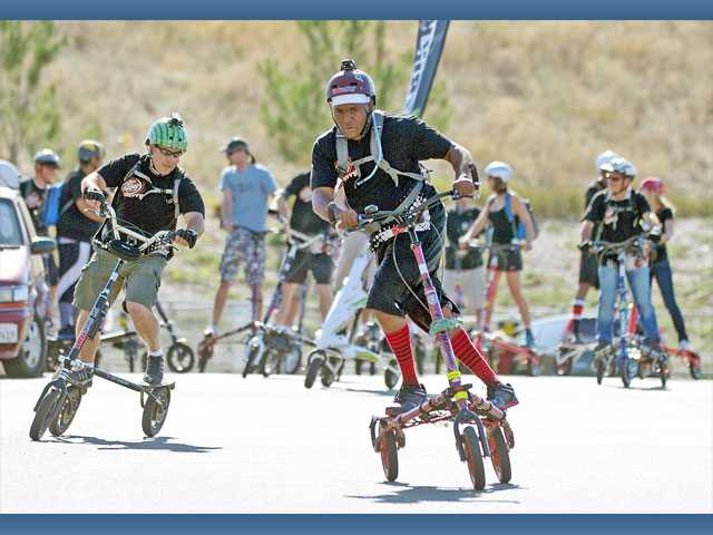 Quincy Jeffries, of Canyon Country, center, leads fellow Trikke riders as they begin their Leap Year Ride outside the Santa Clarita Sports Complex on Saturday. Several members of the group wore colorful knee-high socks in a show of Trikke solidarity.