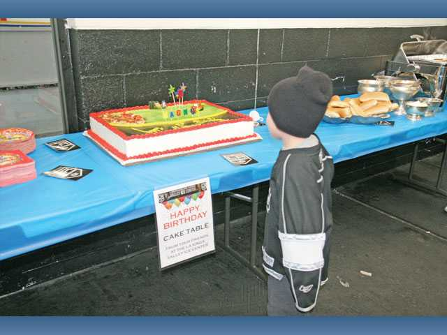 Magnus Eisler, 5, views his birthday cake which was set up in the party room at the Los Angeles Kings Valley Ice Center in Panorama City.