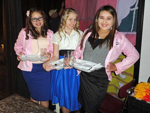 "Arroyo Seco Junior High School students Alyssa Farris (Marty), Samantha Longtin (Sandy) and Alexis Romero (Rizzo) get ready for the next scene in ""Grease."""