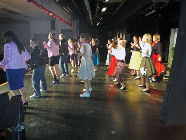 "The Arroyo Seco Junior High School cast of ""Grease"" dance and sing to the finale, ""We Go Together."" The school musical opens tonight and continues through Thursday."