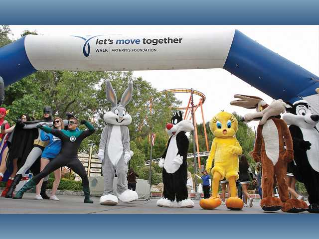 "Costumed characters from Six Flags Magic Mountain in Valencia face participants prior to the start of the ""Let's move together…"" Arthritis Walk."