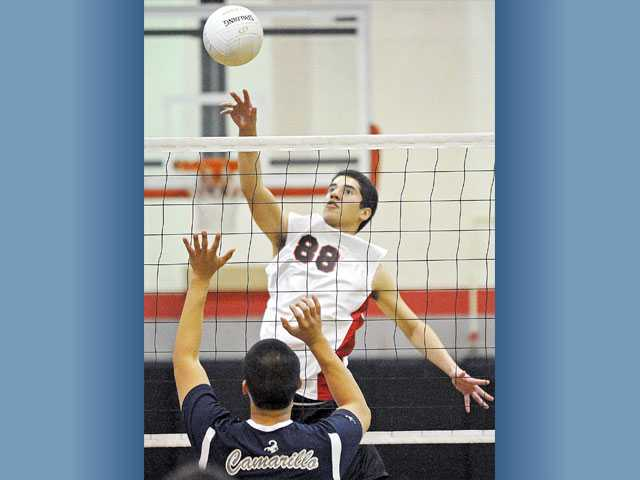 Hart's Nick Ramirez (88) attempts a kill as Camarillo's Brandon Tran prepares to block on Thursday at Hart High.