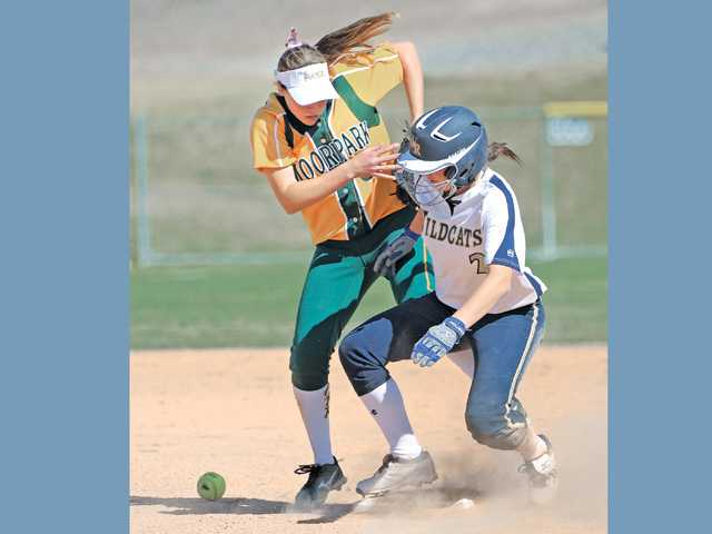West Ranch's Kylie Sorenson, right, steals second base as Moorpark's Madison Fleming tries to make the tag on Saturday at Central Park.