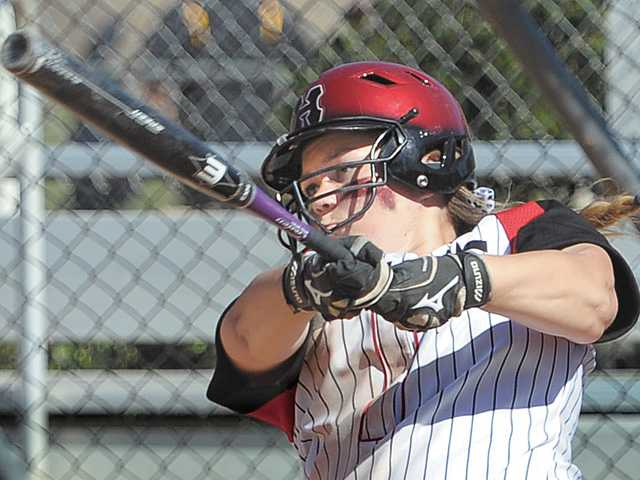 Hart third baseman Tracy Chandless hits an RBI double in the first inning against Oxnard High on Saturday at Central Park. The game finished in a 13-4 victory for Hart after just five innings. It was Hart's second win of the day.