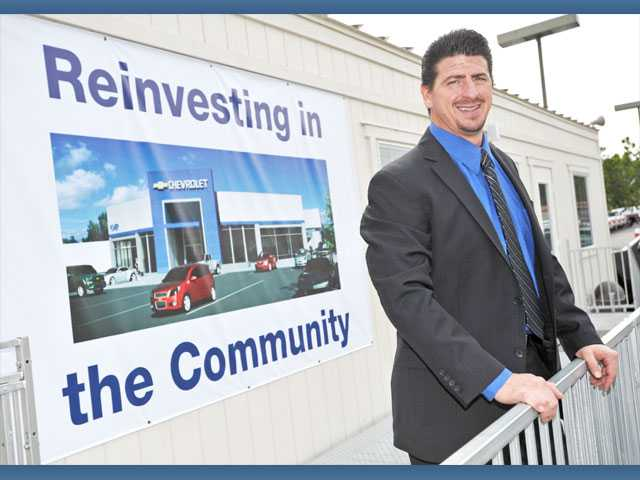 Power Chevrolet general manager Chuck Coia stands outside temporary offices as renovations continue at the Valencia dealership.