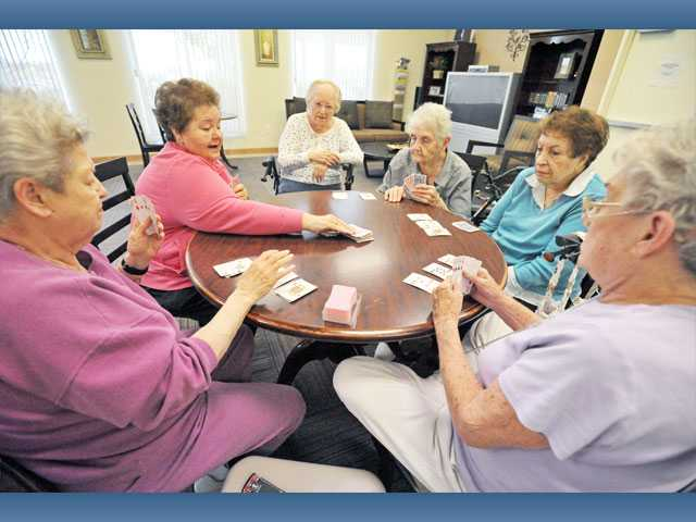 From left, Madeline Tevere, Rose Sordetto, Phyllis Baron, Pat Webster, Sara Rouse and Micki Feather play a game of Madame du pique, a form of rummy, in the activity room.
