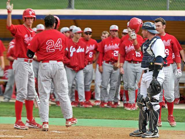 College of the Canyons catcher Drew Sandler reacts as Bakersfield College teammates congratulate Isaiah Turner (24) on a home run in the third inning on Tuesday at COC. Bakersfield defeated Canyons 18-15.