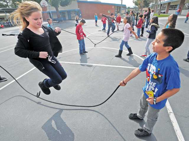 Rily Sheehy, 9, left, jumps rope. See A6 for more pictures.