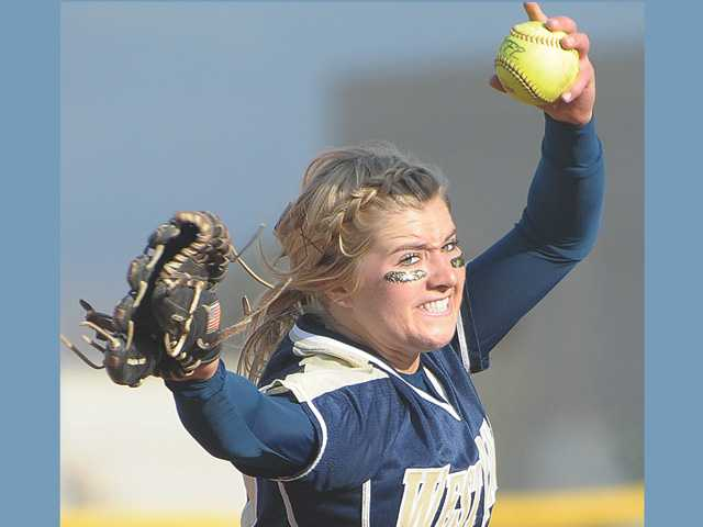 West Ranch pitcher Bailey Foster (12) pitches against Granada Hills at West Ranch on Tuesday afteroon. The Wildcats defeated the Highlanders 11-0.