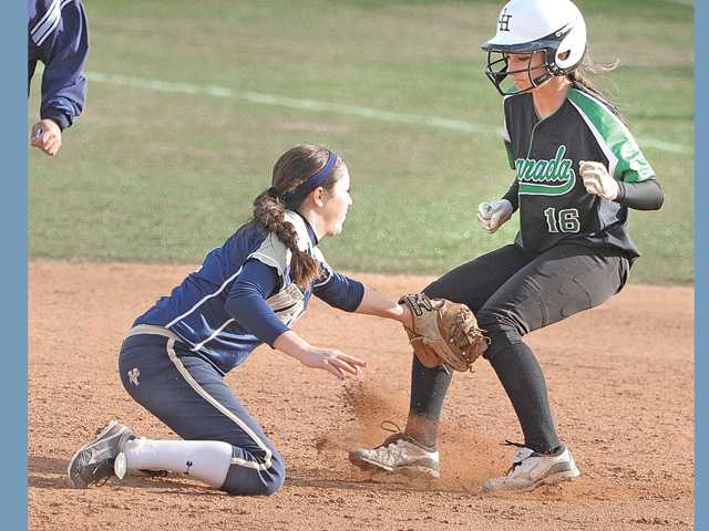 West Ranch's Haley Hineman (1) makes a tag on Granada Hills baserunner Maddie Lesovsky (16) in the third inning at West Ranch High on Tuesday afternoon.