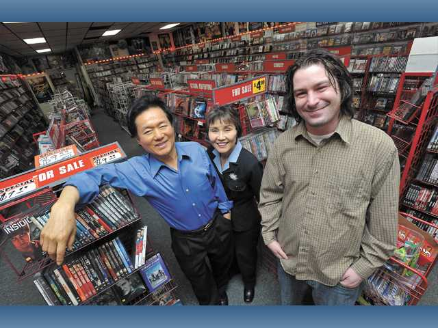From left, John Lee, Gina Lee and Brian Dennis at Video Depot, an independent movie-rental store, in Newhall Tuesday.