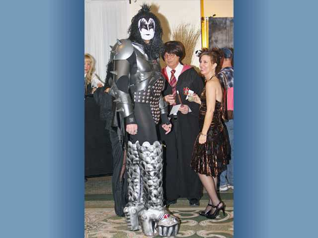 David Gott, left, towered over guests in his KISS costume in the lobby of the Hyatt Regency Valencia.