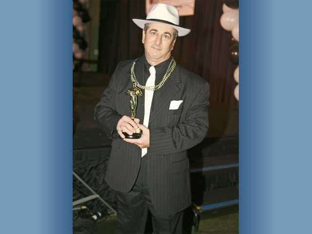 Mike Deluso captured the Waiter of the Year Award for raising the most money during the Celebrity Waiter Dinner.