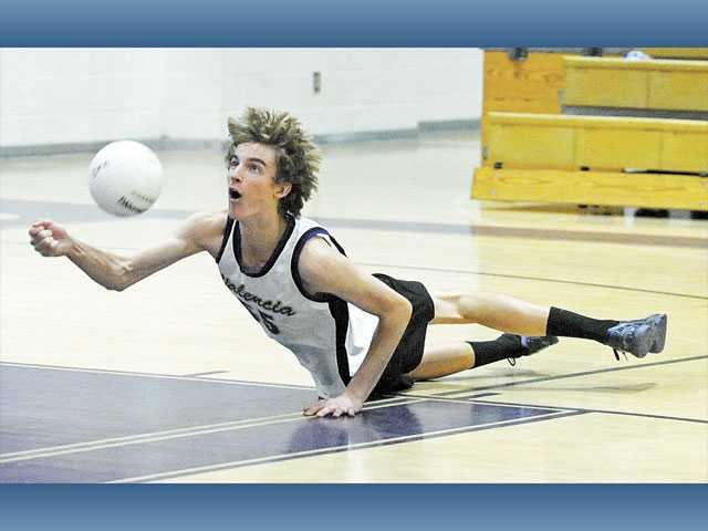 Valencia's Eric Ensing dives to make a dig against Westlake on Wednesday at Valencia High School.