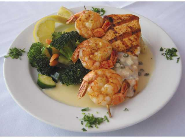 The Grilled King Salmon with grilled shrimp, garlic mashed potatoes and vegetables.