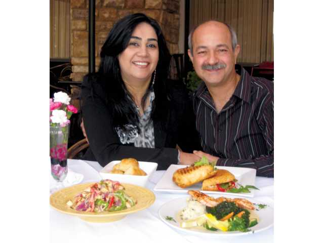 Roza and Jay Hamzehei, owners of Bella Cucina.