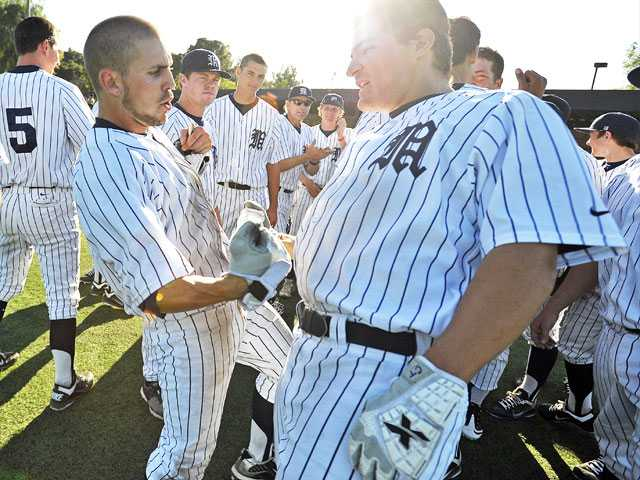 The Master's College's Tanner Leighton, left, and Chris Talley celebrate after Leighton scored the game-winning run against San Diego Christian Thursday at Reese Field.