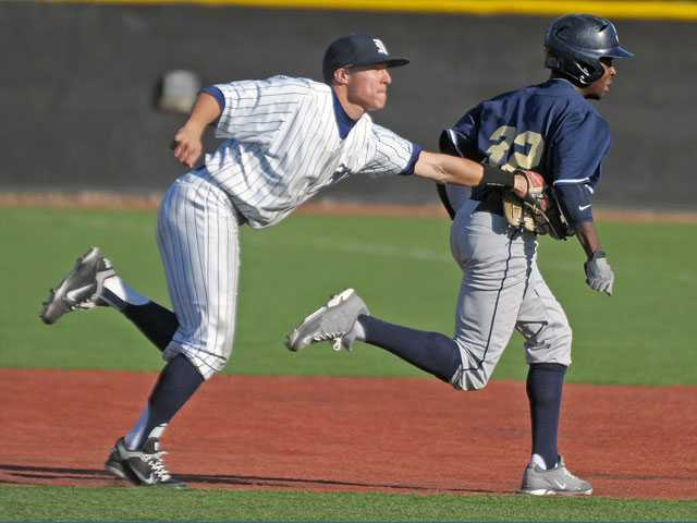 The Master's College infielder Jonathan Popadics chases down San Diego Christian's Cedric Bogan in a rundown on Thursday at Reese Field.