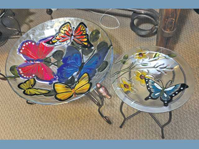 "Butterfly-themed bird baths just say ""spring."""