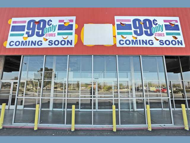 Signs mark the 99 Cents Only Store opening in the building once occupied by the Do It Center on Valencia Boulevard in Santa Clarita on Friday. It's scheduled to open in June.