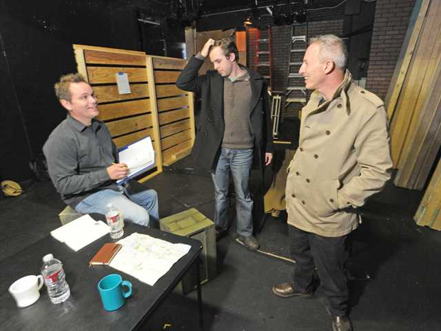 "Left to right, Owston rehearses a scene from ""Journey's End"" with actors Reid Gormly and Daniel Lench."