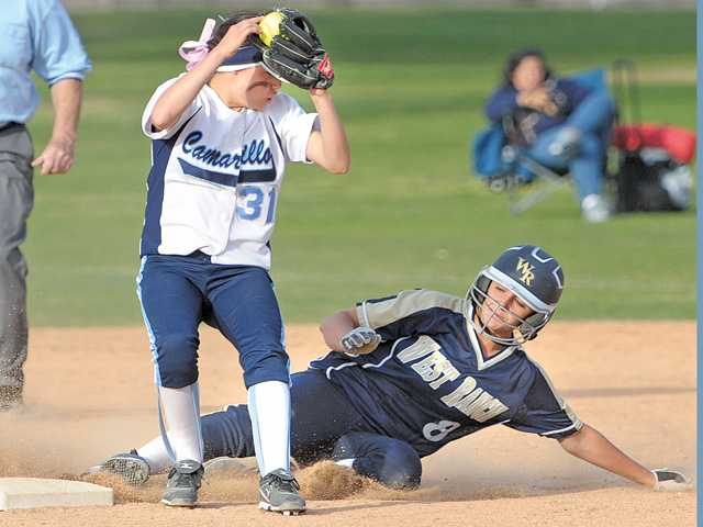 West Ranch base runner Lauren Lindvall (8), right, slides safely into second base as she beats the throw to Camarillo second baseman Shelbie Franc at Central Park on Saturday. West Ranch took the Hart softball tournament title with a 9-1 win.