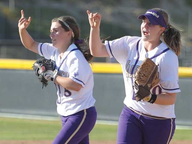 Valencia's Wendy Cardinali, left, and Nicole Joseph signal the outfield after making the second out of the final inning of the Vikings' 1-0 victory over Oxnard on Tuesday at Valencia High School.