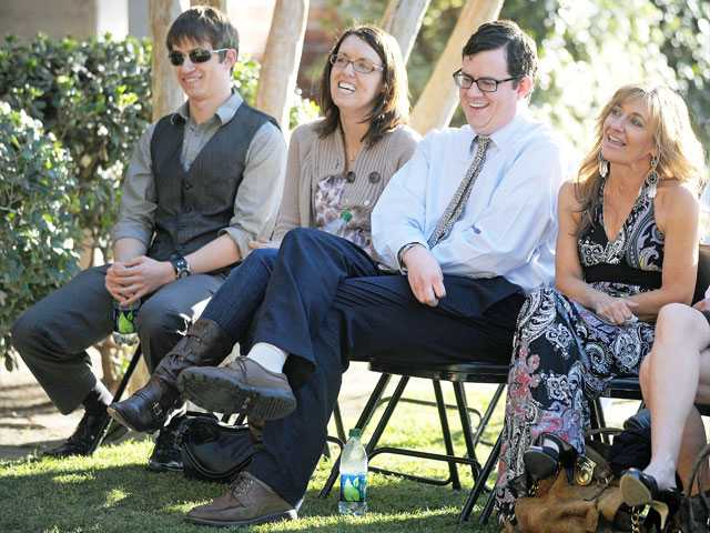 """Family members of William Peter """"Pete"""" Pew, from left, son Keith Pew, daughter-in-law Jenny Pew, son Brian Pew and wife, Debra Pew, share a laugh as they listen to remembrances of the late teacher at a ceremony dedicating the """"F"""" building in his honor at William S. Hart High School in Newhall on Wednesday."""