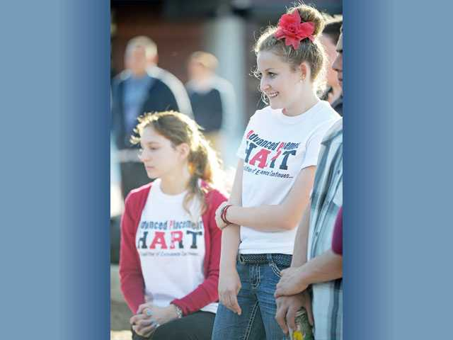 Hart High School seniors Andrea Vincenty, left, and Sammy Spiegel, both 17, wear T-shirts designed in honor of Pew. Pew taught Advanced Placement U.S. History and government classes at the school.
