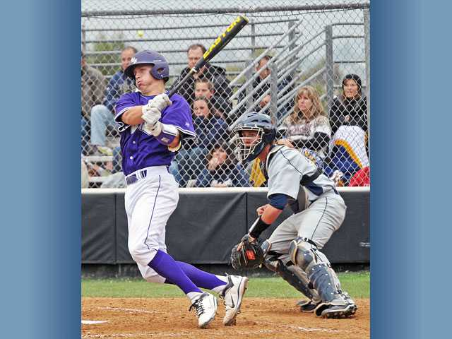 Valencia catcher Brian Mundell hits a triple down the left field line on Friday at Valencia High School.