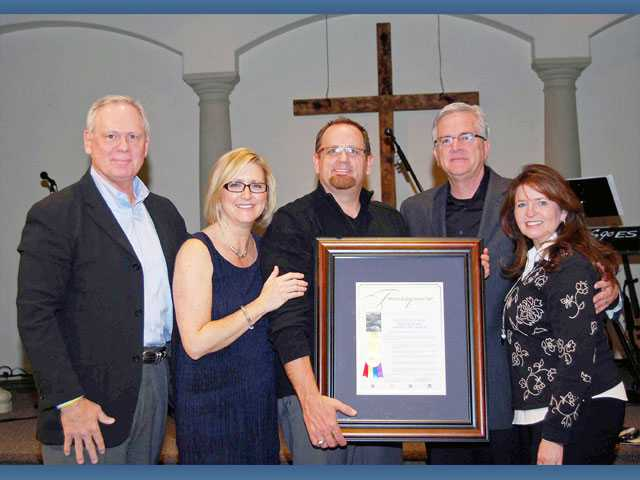 From left, Denominational District Supervisor Dennis Easter, Denominational President Glenn Burris, Senior Pastor Marty Walker and Debbie Walker, the pastor's wife, receive a special certificate marking the 75th anniversary of The Sanctuary.