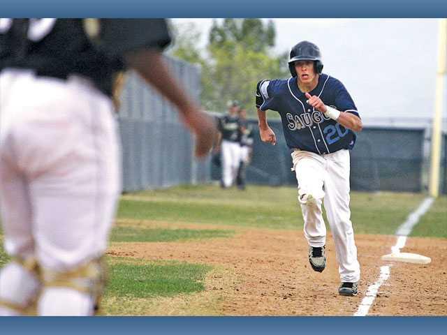 Saugus left fielder Ruben Cardenas streaks home against Golden Valley on  Friday at Golden Valley High ...