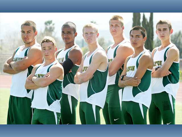 Canyon's boys track and field team, from left, seniors Robert Hooper, Robert Wolfe and Lyndan Coleman, junior Brenden Stach, junior Drew Wolitarsky, junior Joel Estrada and junior Zach Wims, is going for a third Foothill League title in a row this year.