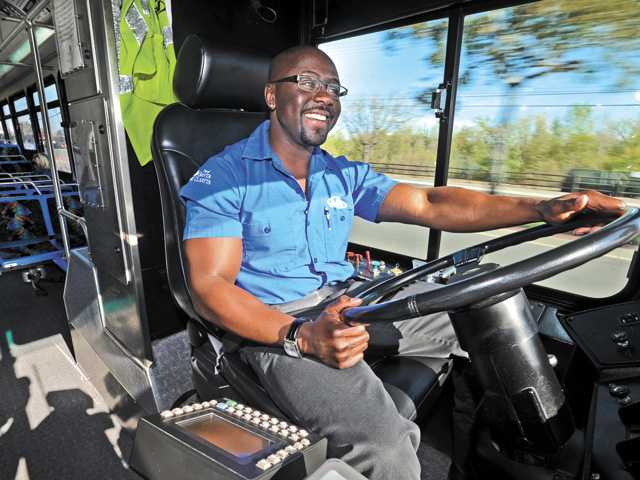 Santa Clarita Transit bus driver George Mbulo drives on his route on Soledad Canyon Road on Wednesday morning.
