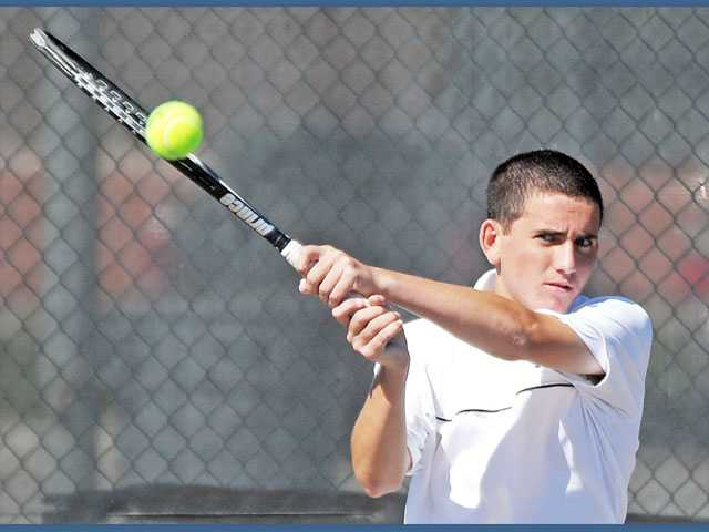 Valencia's No. 2 single player Joey Fernicola hits a return against West Ranch on Tuesday at Valencia High.