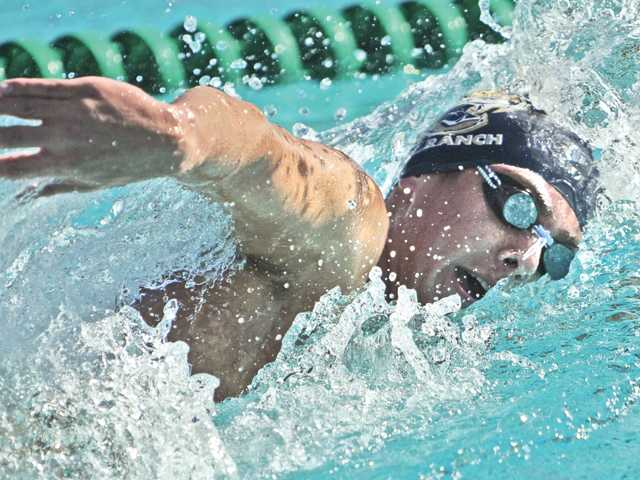 West Ranch High swimmer Tyler Hutten wins the 500-yard freestyle race against Valencia at the Santa Clarita Aquatics Center on Tuesday.
