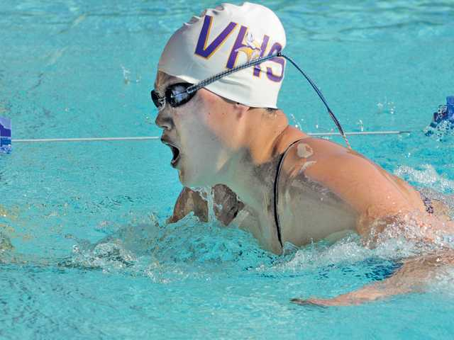 Valencia High swimmer Rebekah Haw touches the wall to win the 500-yard freestyle race against West Ranch High at Santa Clarita Aquatics Center on Tuesday.