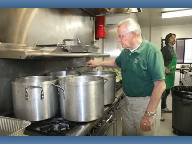 Hilmar Rosenast stirs a pot of corned beef.